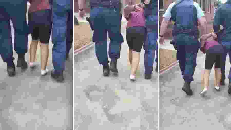 No vídeo é possível ver a menina gritando enquanto está algemada e é puxada por outros dois policiais homens - Reprodução/9news