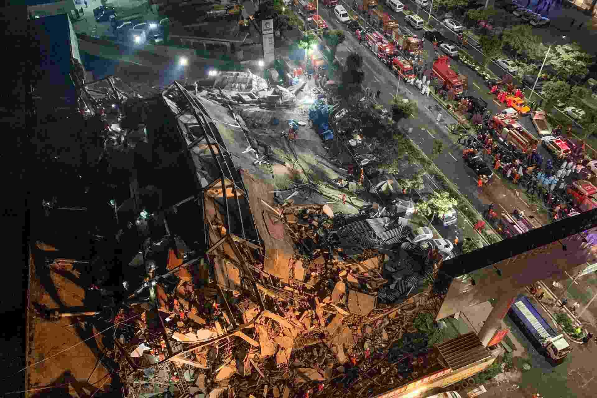 7.mar.2020 - Hotel usado por pessoas em quarentena pela covid-19 desaba na China - AFP