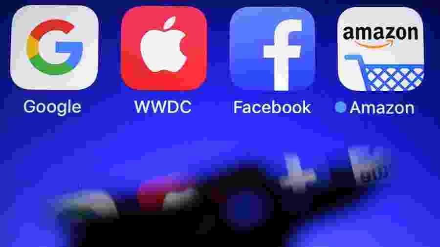 28.set.2017 - Logo das empresas conhecidas como GAFA (Google, Apple, Facebook e Amazon) - Damien Meyer/AFP