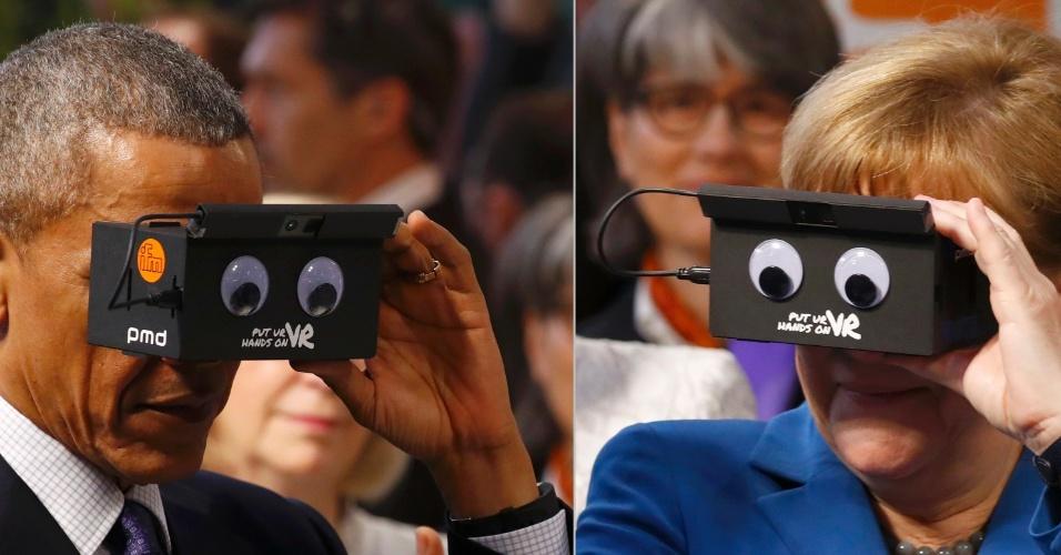 25.abr.2016 - O presidente dos Estados Unidos Unidos, Barack Obama, e a chanceler alemã, Angela Merkel, testam óculos de realidade virtual durante visita a uma feira de Hanover --um dos principais eventos de tecnologia industrial do mundo--, realizada na Alemanha
