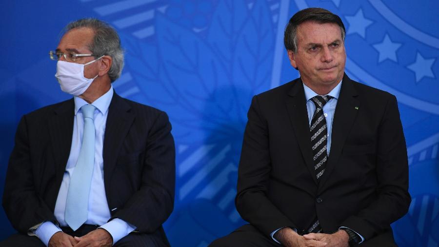 O presidente da república, Jair Bolsonaro, acompanhado do ministro da economia, Paulo Guedes - Mateus Bonomi/Estadão Conteúdo