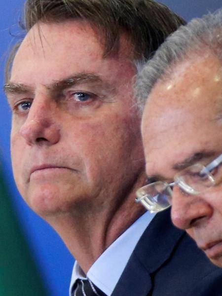 Presidente Jair Bolsonaro e ministro da Economia, Paulo Guedes - ADRIANO MACHADO