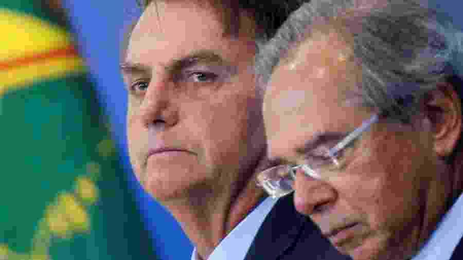 Presidente Jair Bolsonaro e ministro da Economia, Paulo Guedes, durante evento no Palácio do Planalto - ADRIANO MACHADO