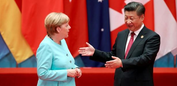 Xi Jinping e Angela Merkel conversam durante reunião do G20 em Hangzhou, na China