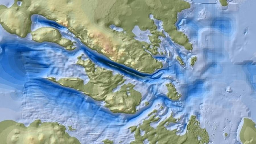 A área profunda de Denman (azul escuro) tem 20 km de largura e 100 km de comprimento - tudo cheio de gelo - BedMachine/UCI/BAS