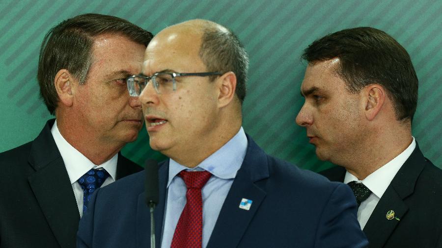 Presidente Jair Bolsonaro, o senador Flávio Bolsonaro e o governador do RJ, Wilson Witzel - Pedro Ladeira/Folhapress