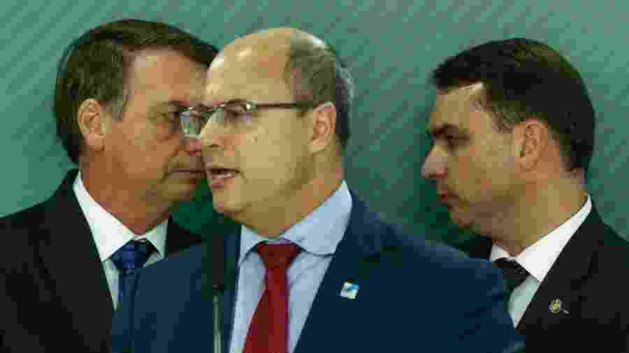 Presidente Jair Bolsonaro, o filho Flávio Bolsonaro e o governador do RJ, Wilson Witzel - Pedro Ladeira/Folhapress