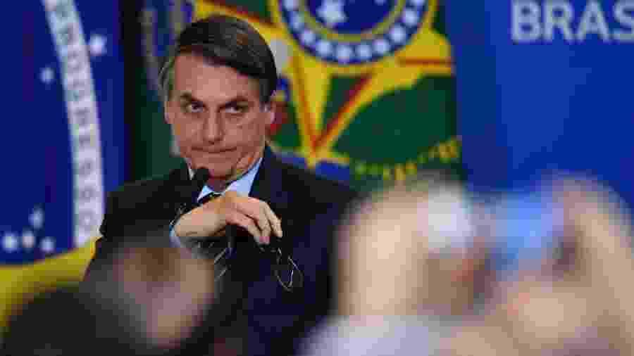 Evento no Palácio do Planalto foi marcado por orações que atribuíram a Deus a vitória eleitoral de Bolsonaro e ações do governo - MATEUS BONOMI/AGIF/ESTADÃO CONTEÚDO