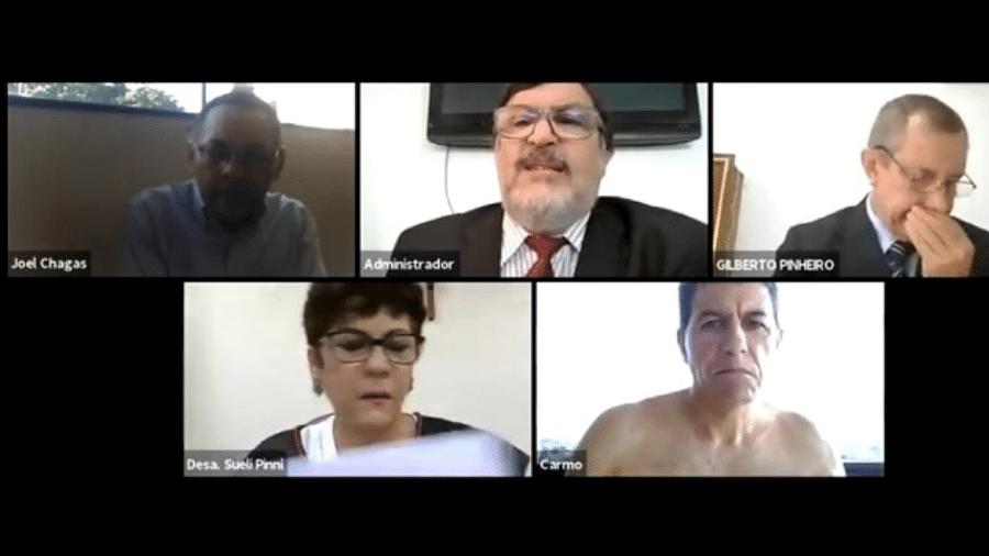 Sessão online realizada pelo Tribunal de Justiça do Amapá com o momento em que o desembargador Carmo Antônio de Souza aparece sem camisa - Reprodução/Zoom