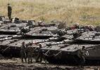 Israel admite que atacou dezenas de alvos iranianos na Síria - Menahem Kahana/AFP