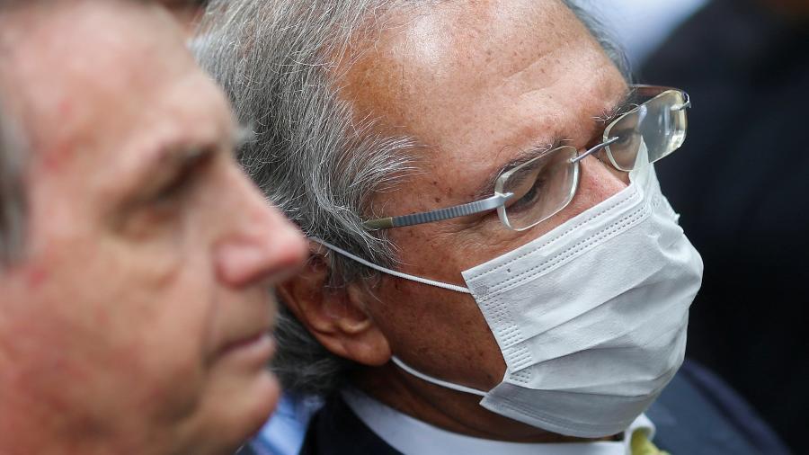 Ministro da Economia, Paulo Guedes, ao lado do presidente Jair Bolsonaro - Adriano Machado