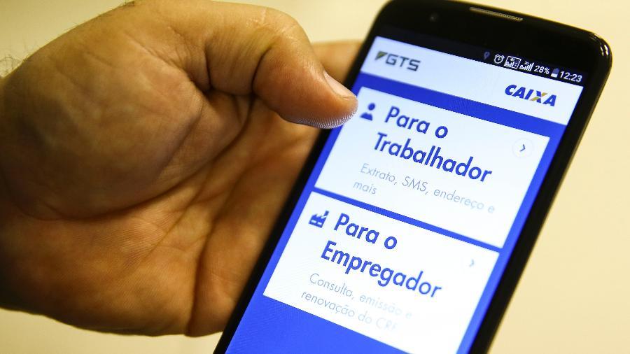 Aplicativo da Caixa Econômica Federal para o FGTS; o fundo teve lucro de R$ 8,467 bilhões em 2020 - Marcelo Camargo/Agência Brasil