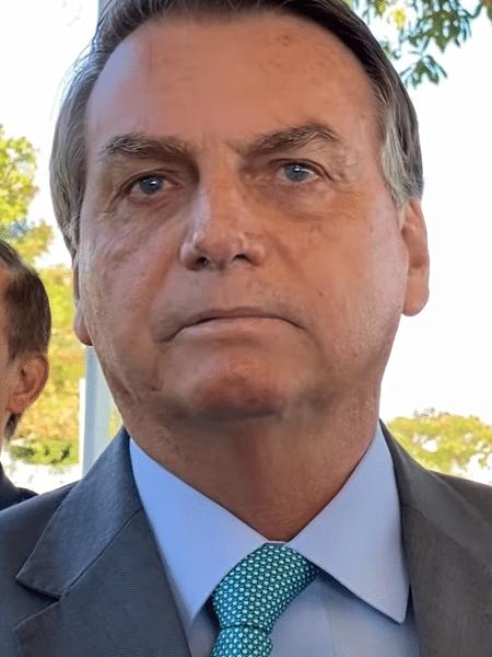 """Bolsonaro e seus apoiadores: ajudando o pessoal """"a voltar a qualquer custo"""" - Reprodução/Foco do Brasil"""