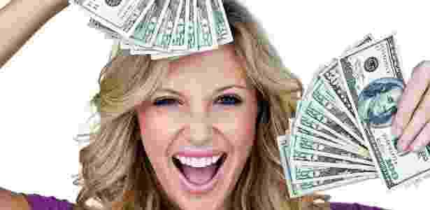 mulher, feliz, jovem, rica, dinheiro, rico, milionario, economia, finanças, investimento - Getty Images - Getty Images