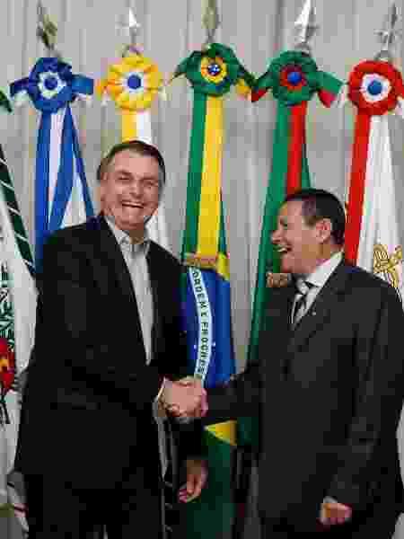 Jair Bolsonaro durante a transmissão de cargo para o Vice-Presidente da República, Hamilton Mourão, antes de viajar para os EUA - Carolina Antunes/PR