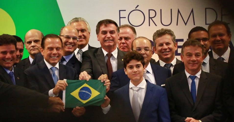 O presidente eleito Jair Bolsonaro, o governador eleito de São Paulo, João Doria e o governador eleito do Distrito Federal, Ibaneis Rocha durante o Fórum de Governadores, no Centro Internacional de Convenções do Brasil (CICB), em Brasília (DF), nesta quarta-feira (14)