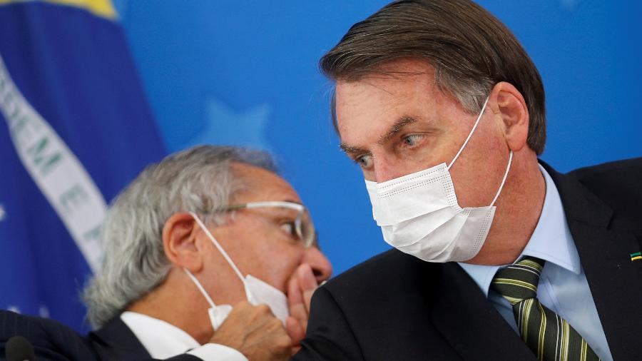 Presidente Jair Bolsonaro e Ministro da Economia, Paulo Guedes, durante coletiva de anúncio de medidas contra o coronavírus - ADRIANO MACHADO