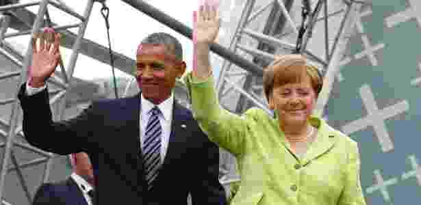25.mai.2017 - Barack Obama ao lado de Angela Merkel durante evento em Berlim - REUTERS/Fabrizio Bensch