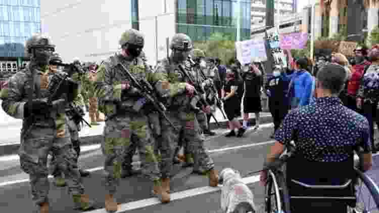 A reação do governo de Donald Trump aos protestos foi enviar a Guarda Nacional às ruas - AFP - AFP