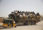 Cidade do Níger é ponto de encontro de ilegais em fuga da África - Akintunde Akinleye/Reuters