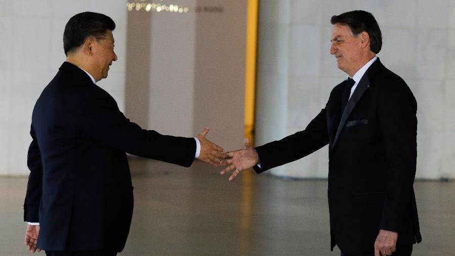 13.nov.2019 - Xi Jinping e Jair Bolsonaro em encontro dos BRICS, em Brasília -  Sergio LIMA / AFP
