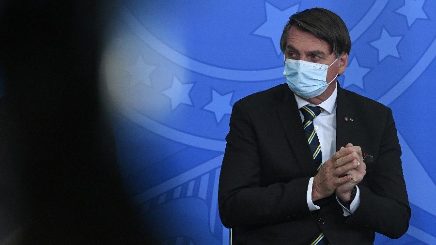 O presidente Jair Bolsonaro (sem partido) foi denunciado pela forma como encarou a pandemia no começo da crise - Edu Andrade/Fatopress/Estadão Conteúdo