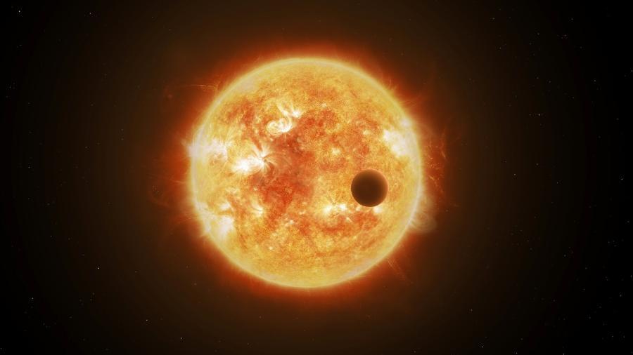 Impressão artística de um trânsito planetário, quando o planeta se coloca na linha de visada entre nós e sua estrela hospedeira - ESA/ATG medialab