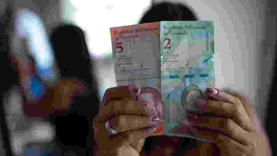Bolívar soberando tem cinco zeros a menos que a moeda anterior - Mauro Pimentel/AFP
