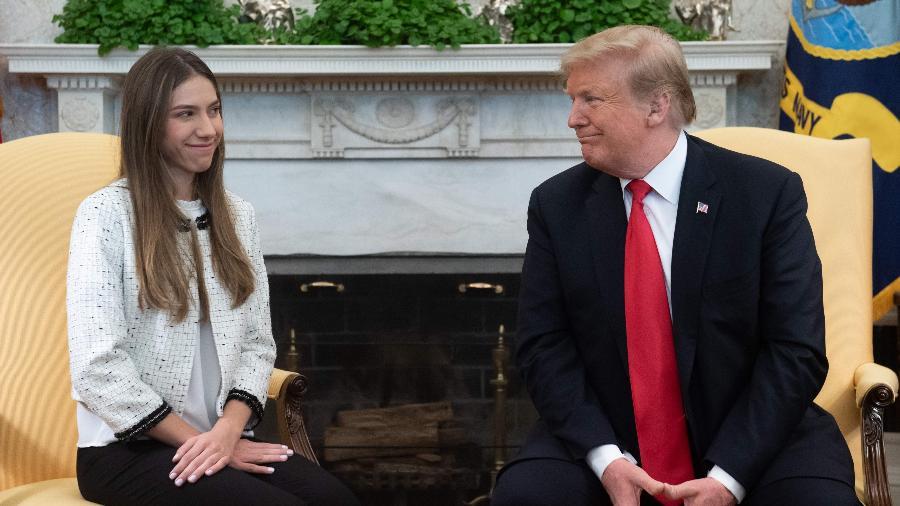 27.mar.2019 - Presidente dos EUA, Donald Trump, recebe Fabiana Rosales, esposa de Juan Guaidó, no Salão Oval da Casa Branca - Saul Loeb/AFP