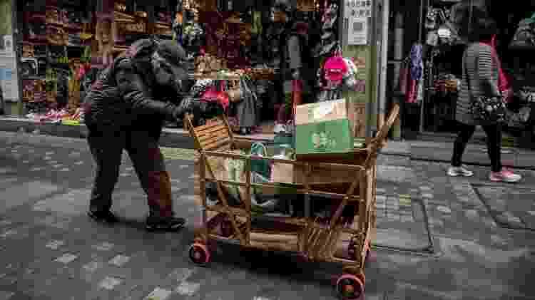 Apesar do sistema político-econômico de cunho socialista, há uma desigualdade gigantesca entre ricos e pobres na China - Getty Images - Getty Images
