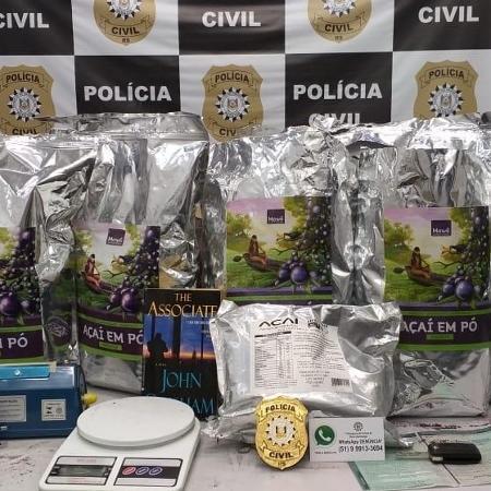Cocaína preta foi armazenada dentro de embalagens de açaí, para enganar policiais - Divulgação/Polícia Civil