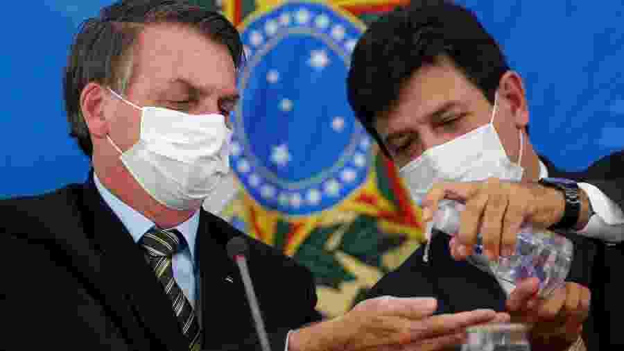 Presidente Jair Bolsonaro e ministro da Saúde, Luiz Henrique Mandetta, durante entrevista coletiva em Brasília -