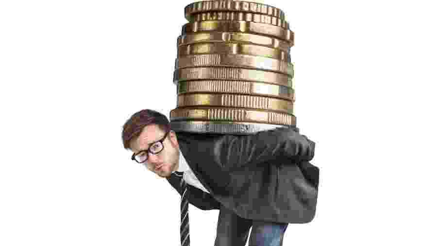 Imposto; peso dos impostos; dívidas; endividado - Getty Images