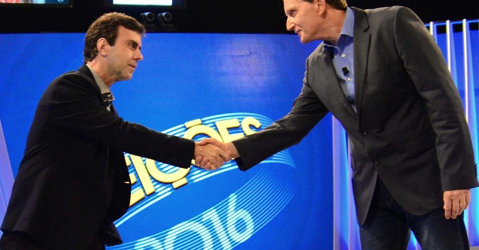 28.out.2016 - Os candidatos à prefeitura do Rio Marcelo Freixo (PSOL, à esq.) e Marcelo Crivella (PRB) no último debate da campanha, organizado pela Rede Globo