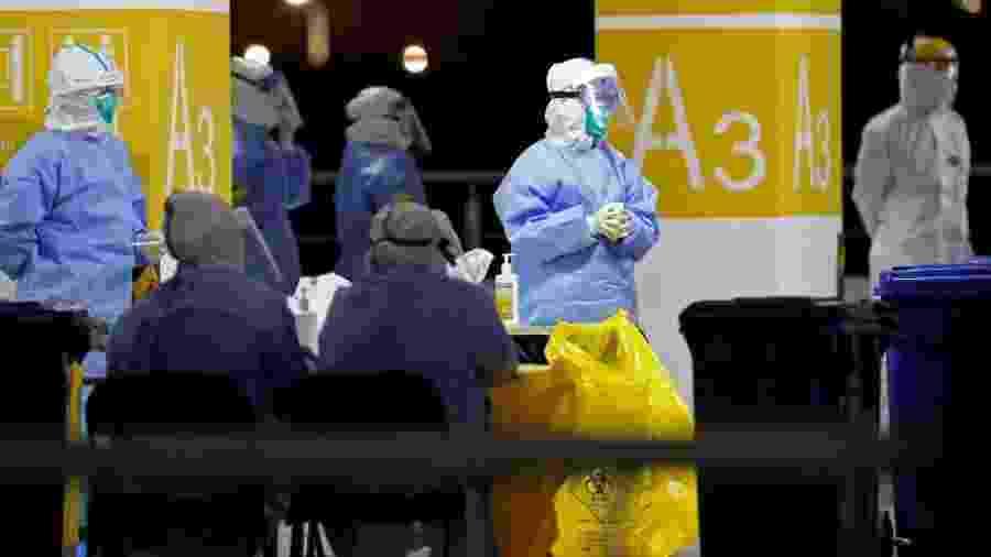 Medidas sanitárias contra covid-19 no Aeroporto de Pudong, em Xangai - AFP