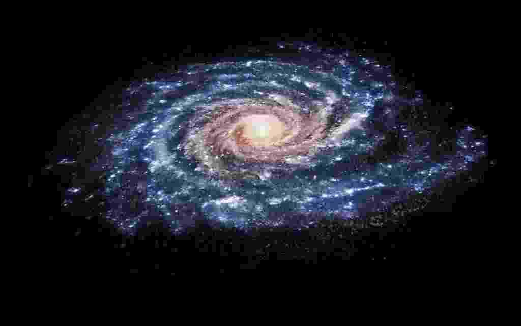 ESTRELAS FUJONAS - As cerca de seis milhões de estrelas da Via Láctea orbitam o centro da galáxia em um movimento que seria totalmente simétrico, não fossem algumas estrelas fujonas, que seguem cursos diferentes. Cientistas que utilizaram dados do observatório espacial Gaia para rastrear o movimento das estrelas da Via Láctea descobriram que há um grupo que segue caminhos diferentes através da galáxia -- ainda que orbitem seu centro. A rotação não uniforme pode ser fruto da influência da galáxia anã de Sagitário, que passou perto da Via Láctea entre 300 e 900 milhões de anos atrás. - Teresa Antoja/Nature