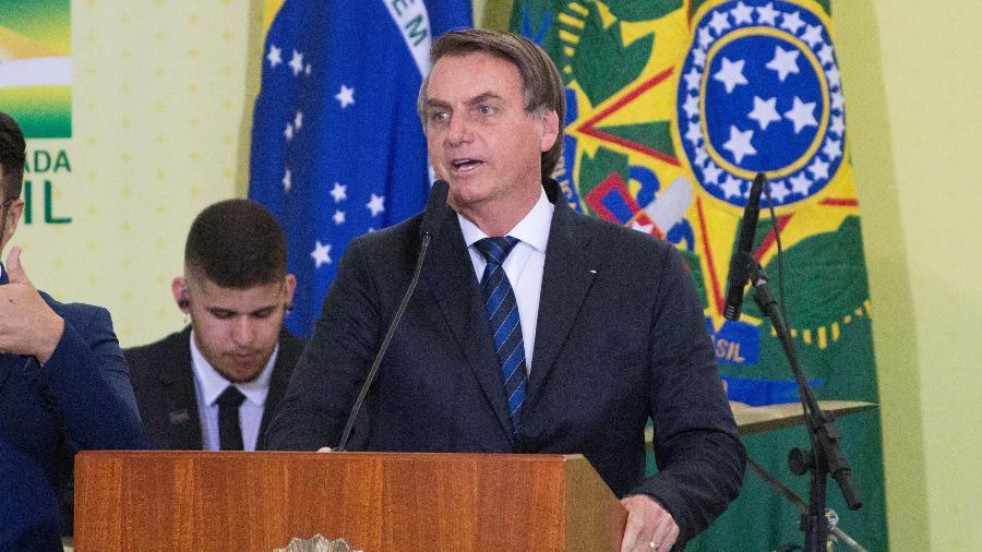 19.dez.2019 - O presidente Jair Bolsonaro acompanha a Cantata de Natal no Palácio do Planalto, em Brasília - Frederico Brasil/Futura Press/Estadão Conteúdo