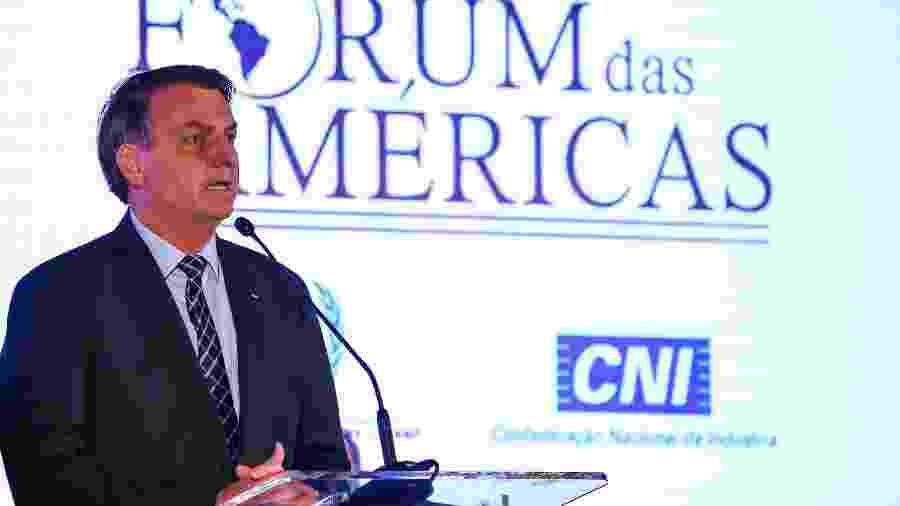 10.mar.2020 - O presidente Jair Bolsonaro discursa na abertuda do Fórum das Américas, em Miami (EUA) - Zak Bennett/AFP