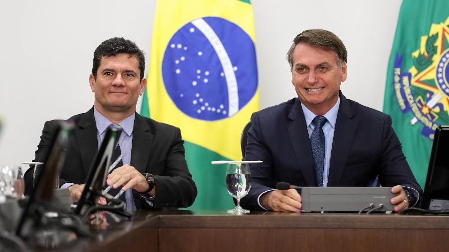 O presidente Jair Bolsonaro (sem partido) em reunião com o então ministro da Justiça, Sergio Moro - Marcos Corrêa/PR