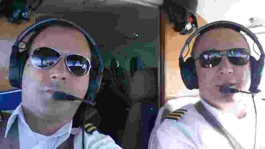 Benedito Fernando Ricci e Matheus Pasquotti, durante um voo - Reprodução/Facebook