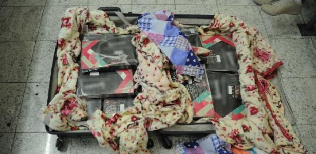 18.set.2018 - Caixas de maquiagens onde estavam escondidas as drogas - Divulgação/Polícia Federal