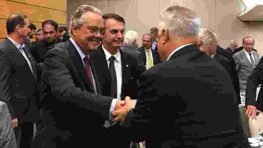 Jair Bolsonaro e o presidente da Firjan, Eduardo Eugênio Gouvêa Vieira (à esq.) - Hanrrikson de Andrade/UOL