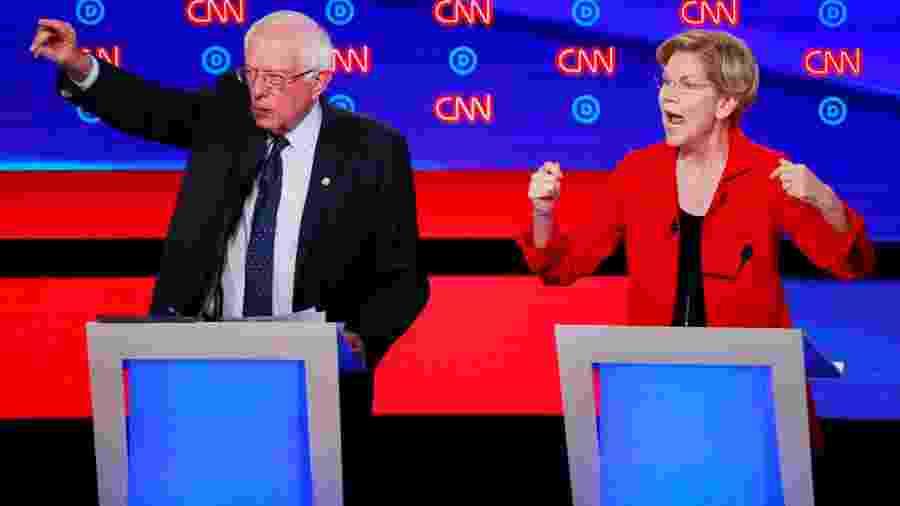 O senador Bernie Sanders e a senadora Elizabeth Warren durante a primeira noite de debate entre pré-candidatos do Partido Democrata à presidência dos EUA - Lucas Jackson/Reuters
