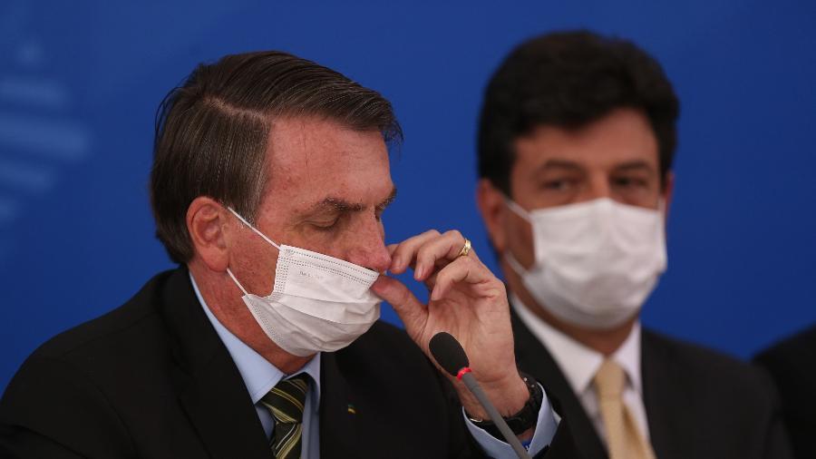 O presidente Jair Bolsonaro e o ministro da Saúde, Luiz Henrique Mandetta, em coletiva sobre o coronavírus no Brasil - Pedro Ladeira/Folhapress