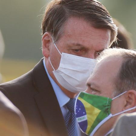 Presidente Jair Bolsonaro e o ministro interino da Saúde, Eduardo Pazuello - Adriano Machado/Reuters