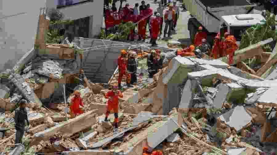 """""""Temos vários tipos de luto que precisam ser identificados e acompanhados neste processo. No momento, tudo se resume a desespero, dor e desamparo"""", diz Renê Vieira Dinelli, que coordena os voluntários - RODRIGO PATRICIO/AFP"""
