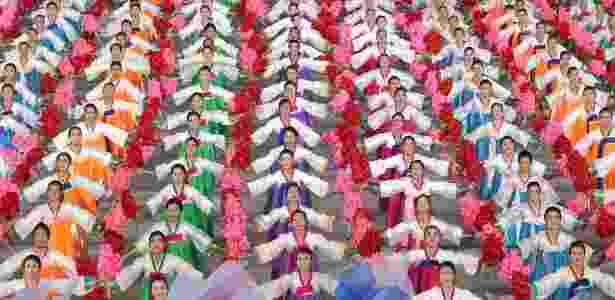 Cerca de 150 mil espectadores participaram do evento, que envolve dezenas de milhares de dançarinos e acrobatas - AFP - AFP