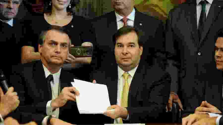 A ação que deve ser julgada pode afetar tanto o presidente Jair Bolsonaro quanto o presidente da câmara, Rodrigo Maia - Handout/Reuters
