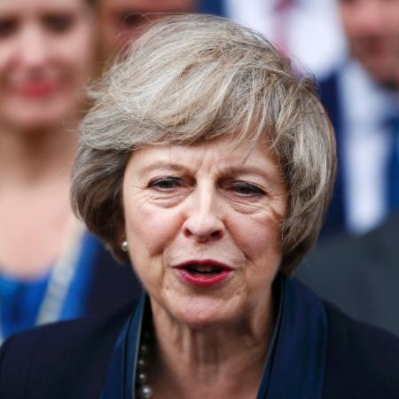 A primeira-ministra britânica Theresa May, que tem passado por uma prova de fogo no Parlamento - Neil Hall/ Reuters