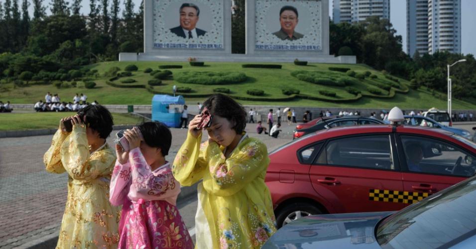 27.Jul.2018 - Mulheres enfrentam calor na Coreia do Norte